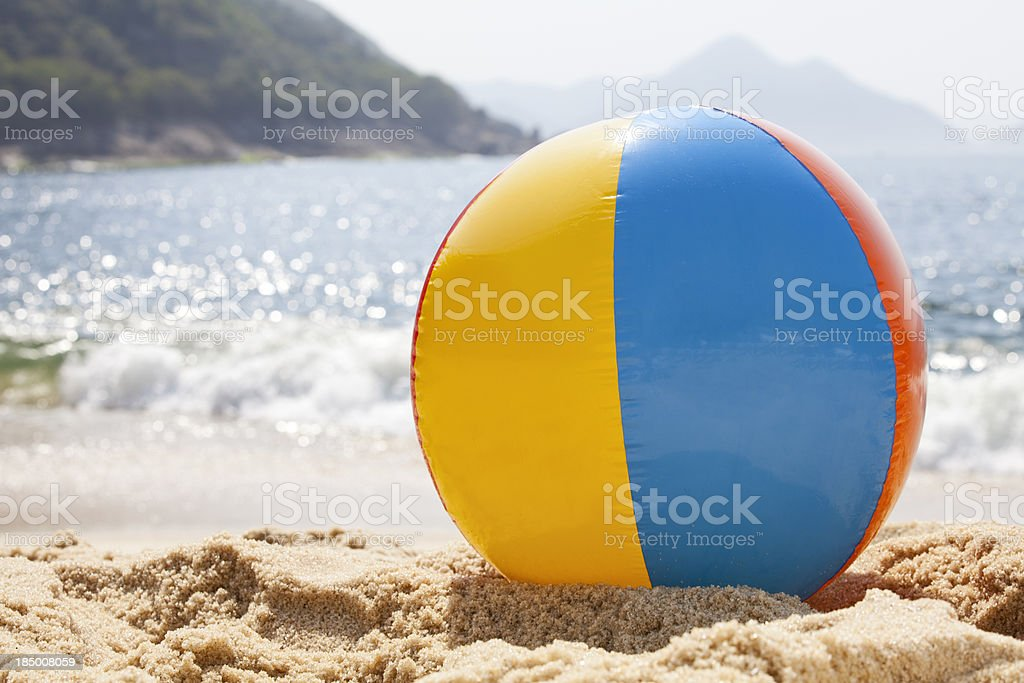 Beach ball by the ocean stock photo
