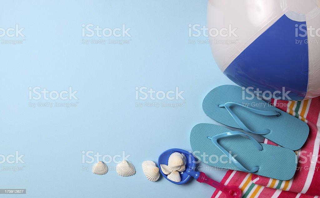 Beach ball flip flop and seashells royalty-free stock photo