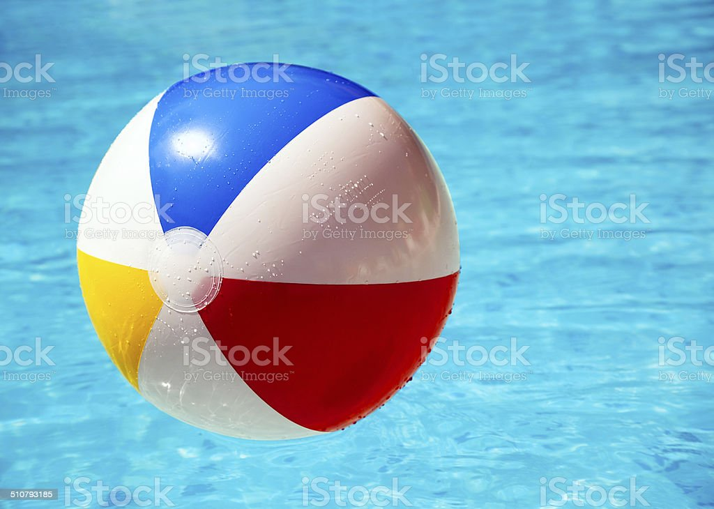 Beach ball in swimming pool stock photo