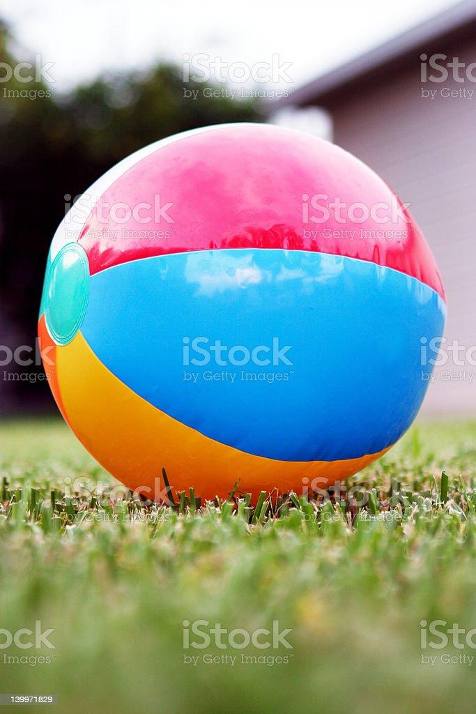 Beach ball on grass royalty-free stock photo