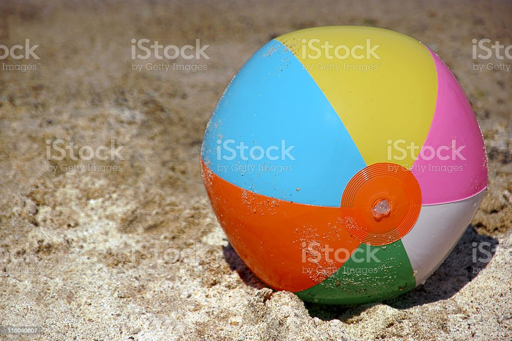Beach Ball on Sand with Copy Space royalty-free stock photo