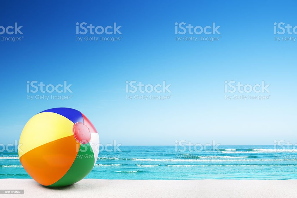 Beach ball on the beach on a clear sunny day stock photo
