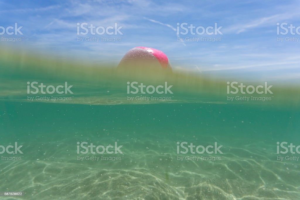 Beach ball on the clear sea at Pedn Vounder, Cornwall stock photo