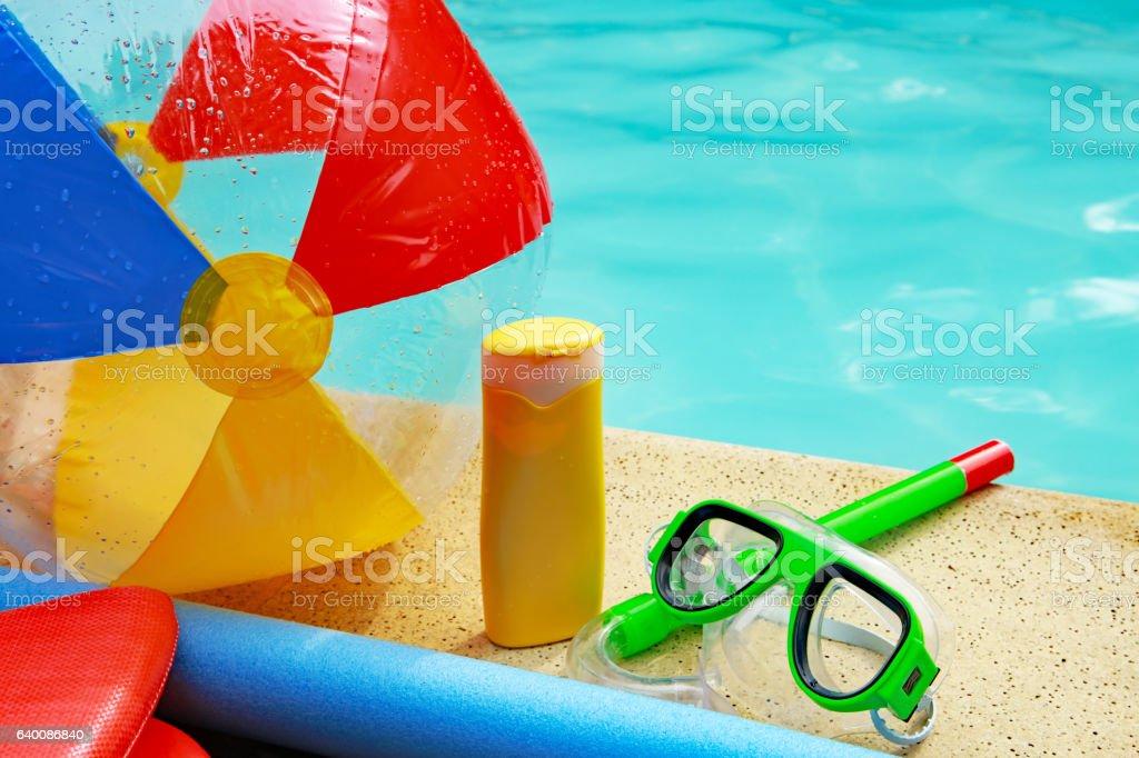 Beach Ball, Sunscreen, Swimming Googles at Swimming Pool in Summer stock photo