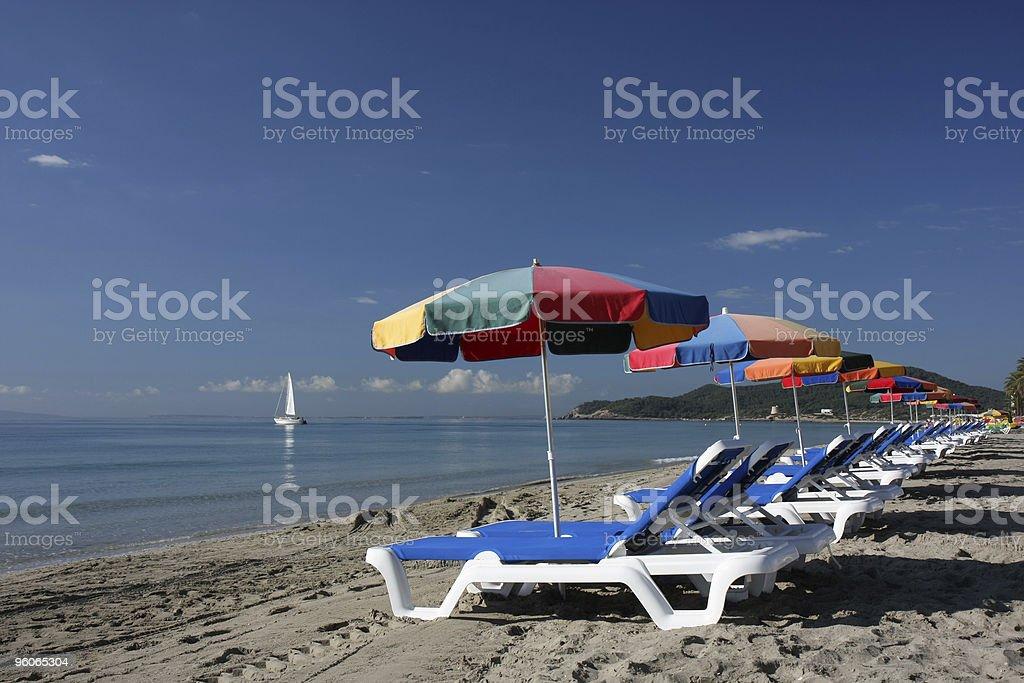 beach beds and sun umbrellas at Ibiza stock photo