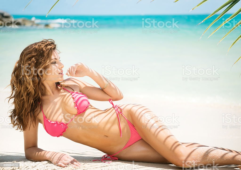 Beach Bikini Beauty with Palm Tree Textures on her Skin stock photo