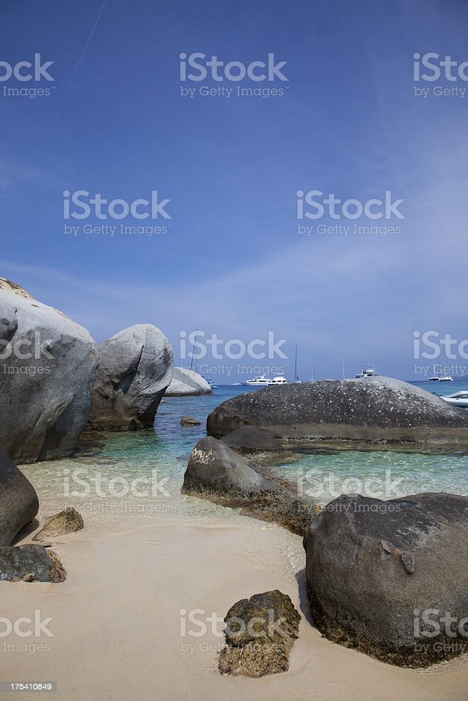 Beach, Bolders and Boats stock photo