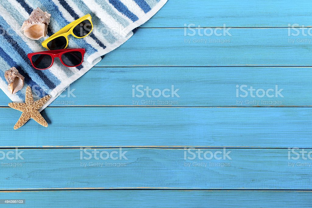 Beach border with blue wood decking royalty-free stock photo