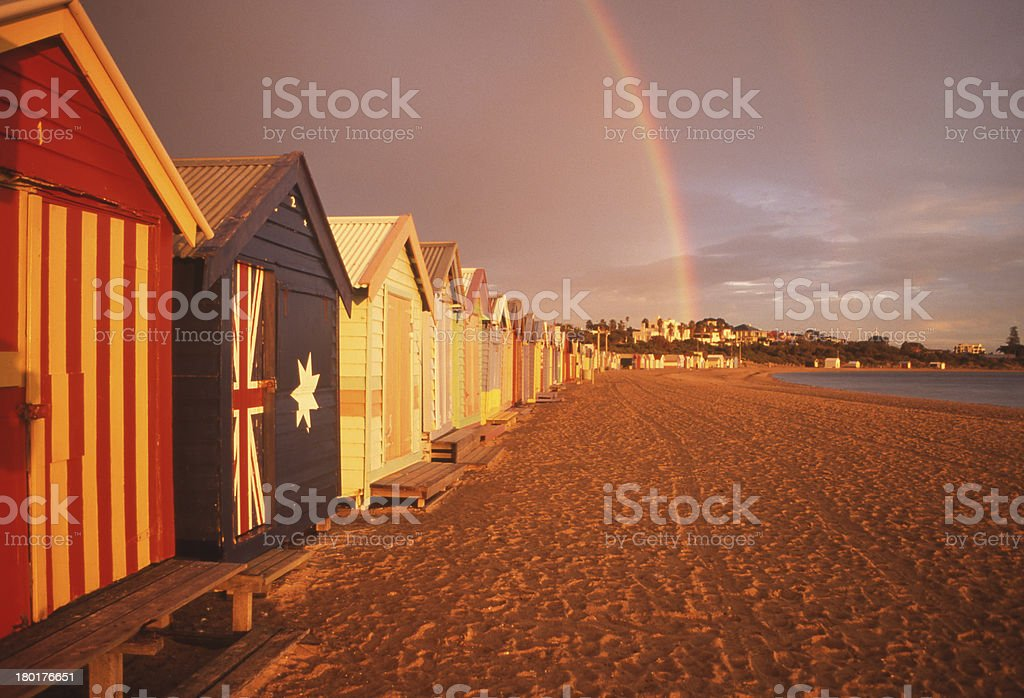 Beach Boxes with Rainbow stock photo