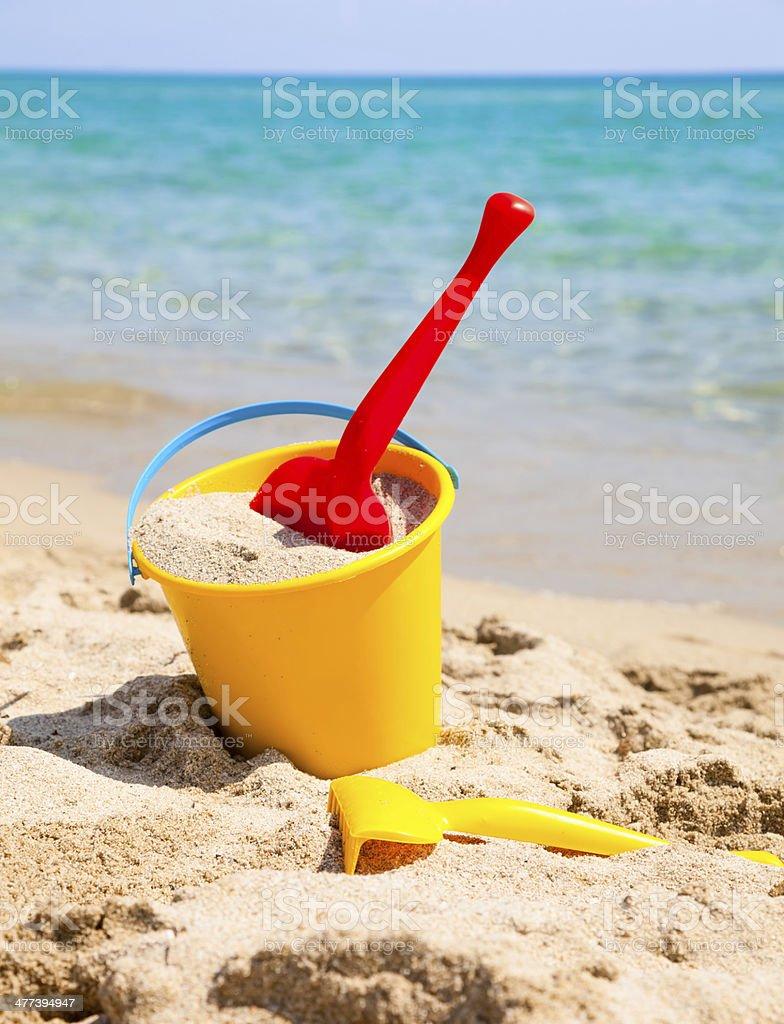 Beach bucket with spade stock photo