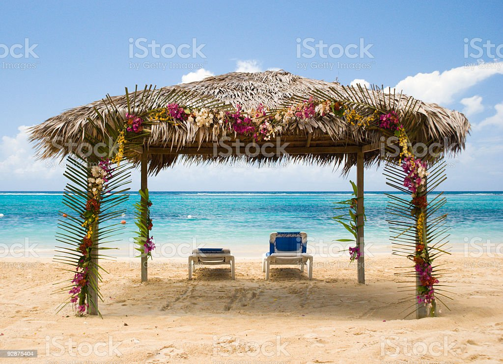 Beach cabana for two facing the Caribbean Sea royalty-free stock photo