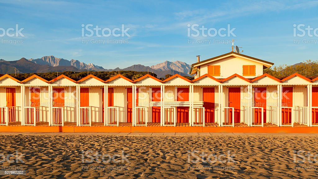 beach cabins on a sunset moment stock photo