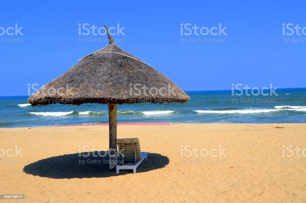 Beach chair and umbrella at Bay of Bengal, Chennai stock photo