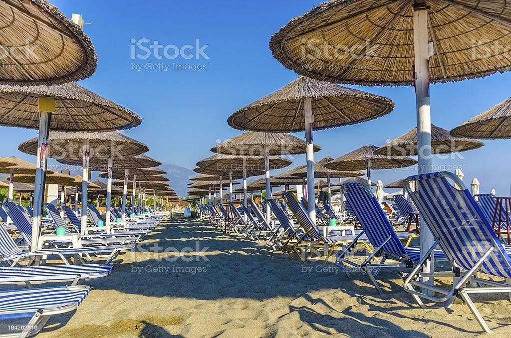 Beach chair and umbrella on sand beach. royalty-free stock photo