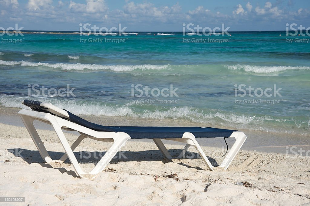 Beach chair by the ocean royalty-free stock photo