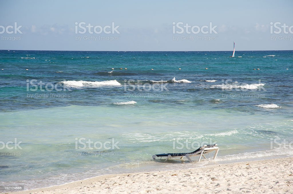 Beach chair in the ocean royalty-free stock photo