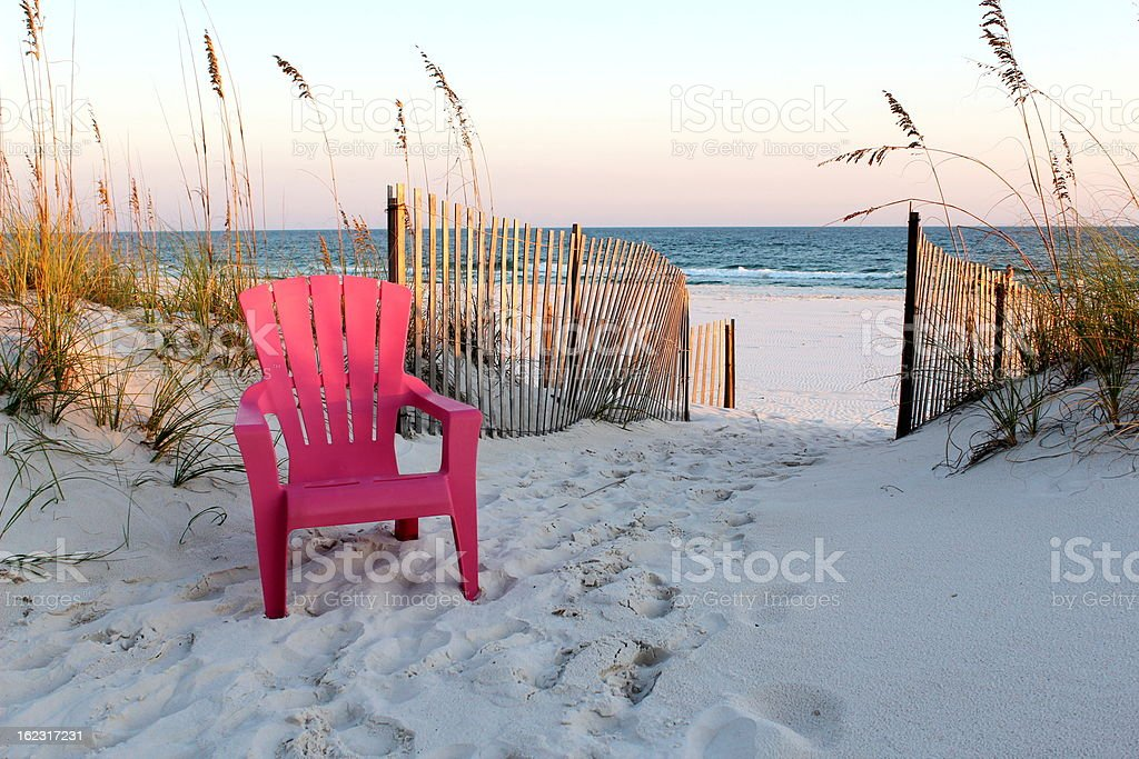 Beach chair leading to the Gulf of Mexico. stock photo