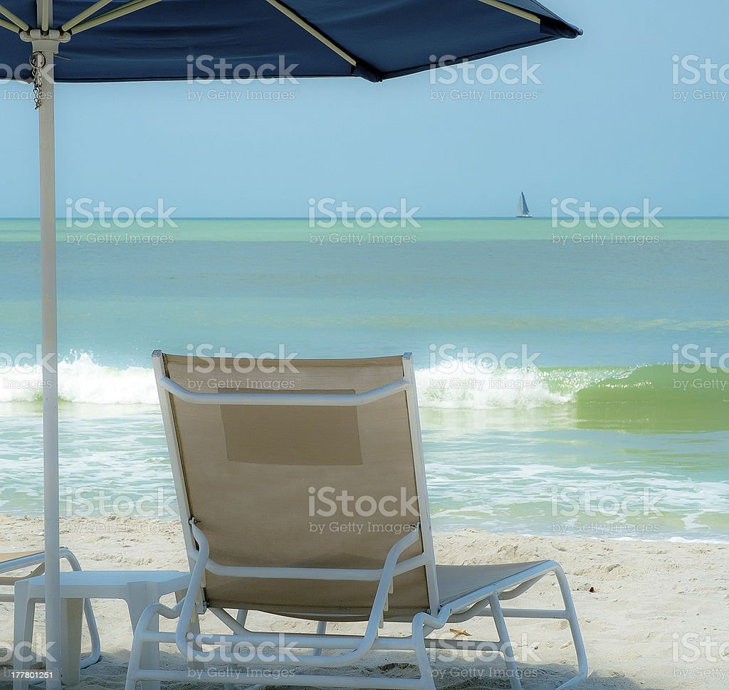 Beach Chair Under an Umbrella for Relaxation, Naples Florida USA stock photo