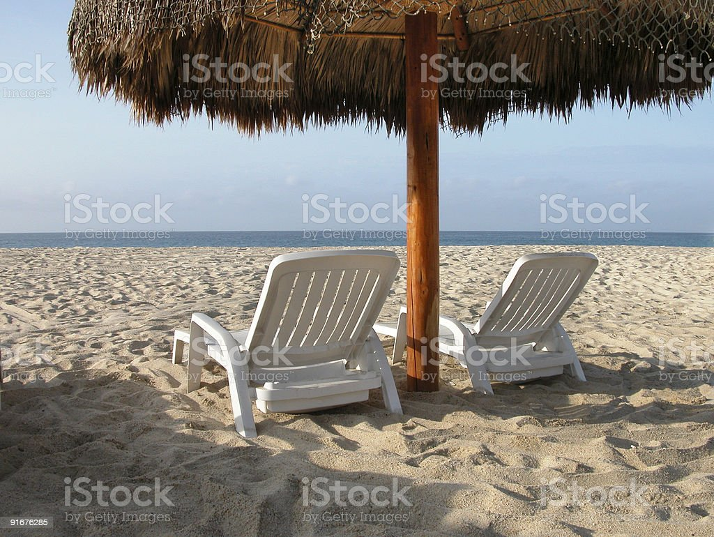 Beach chairs and hut royalty-free stock photo