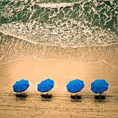 Beach chairs and ocean waves