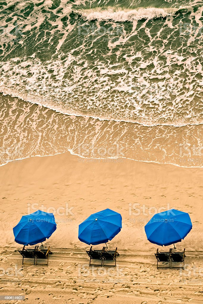 Beach chairs and ocean waves stock photo