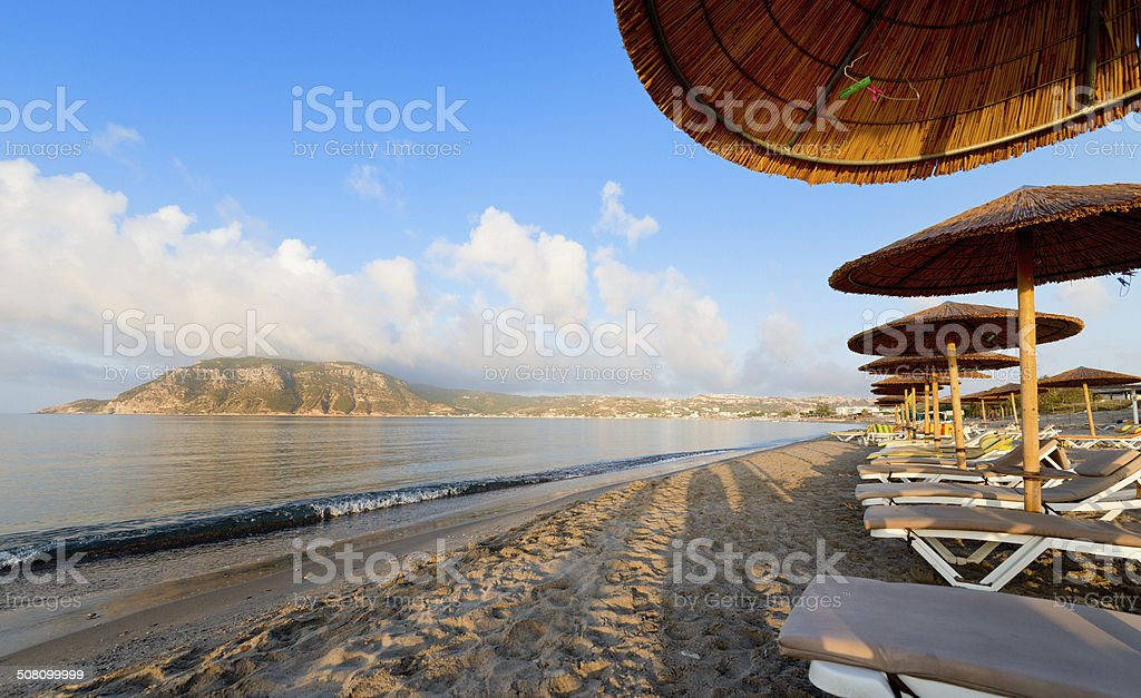 beach chairs and parasols stock photo