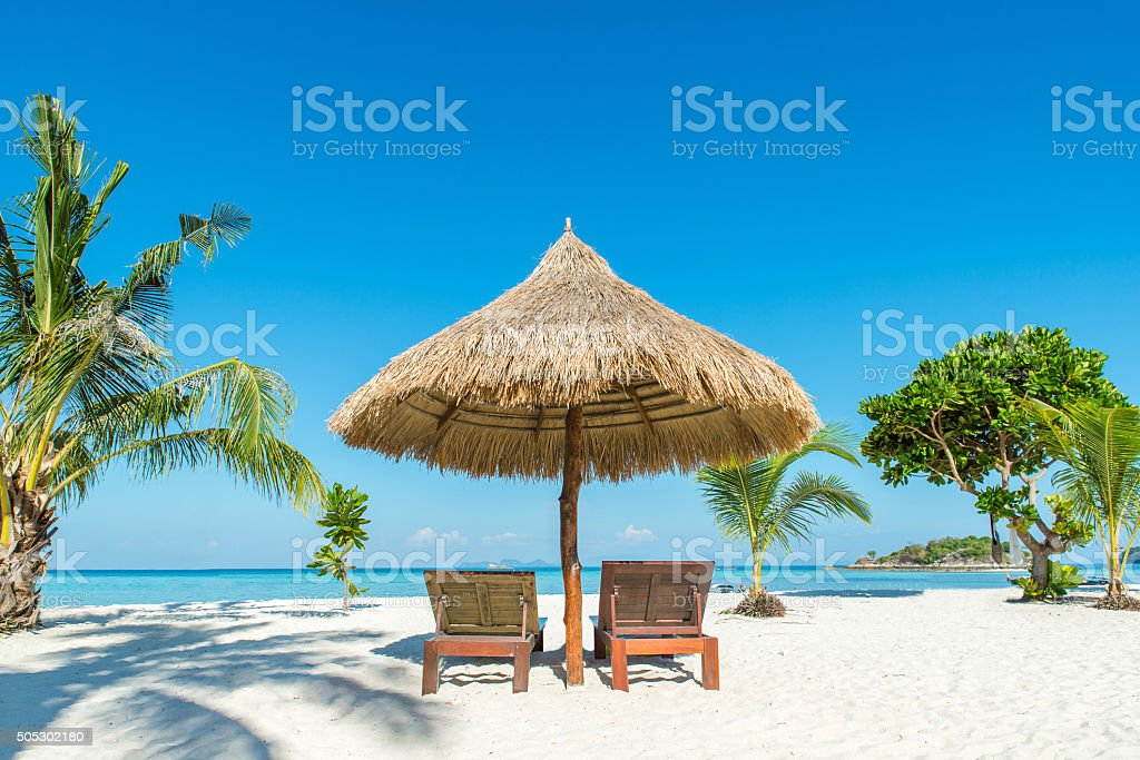 Beach Chairs and Umbrella on island in Phuket, Thailand stock photo