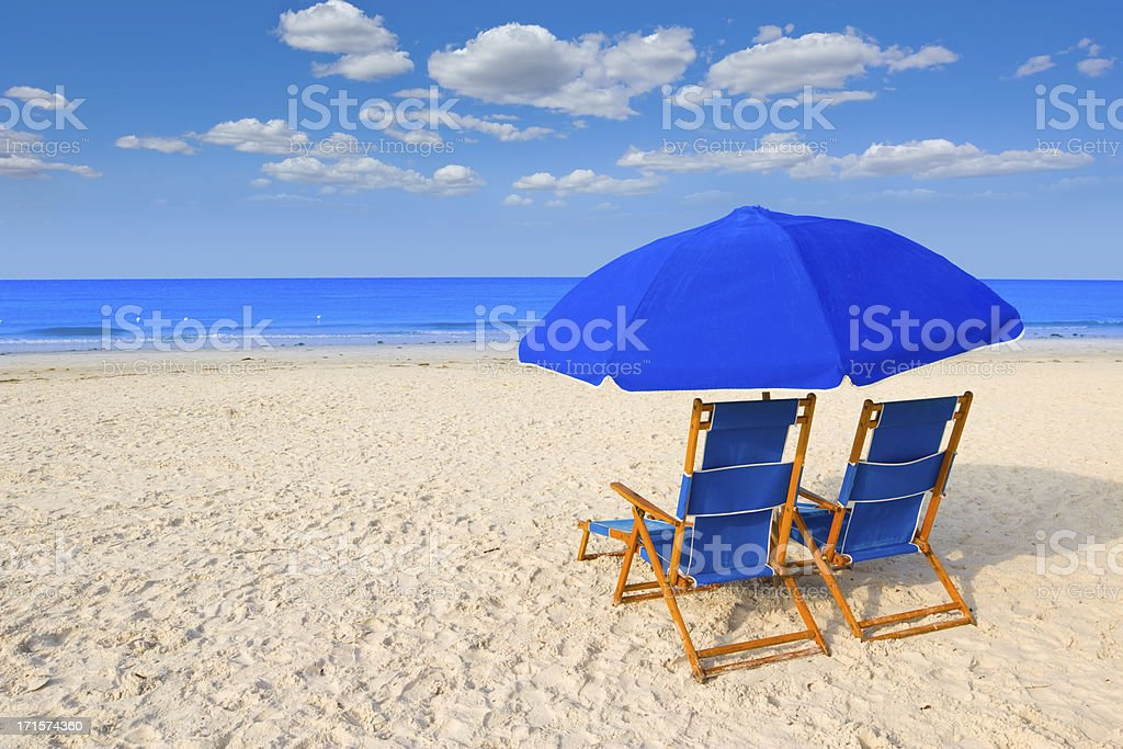 Beach chairs and umbrella stock photo