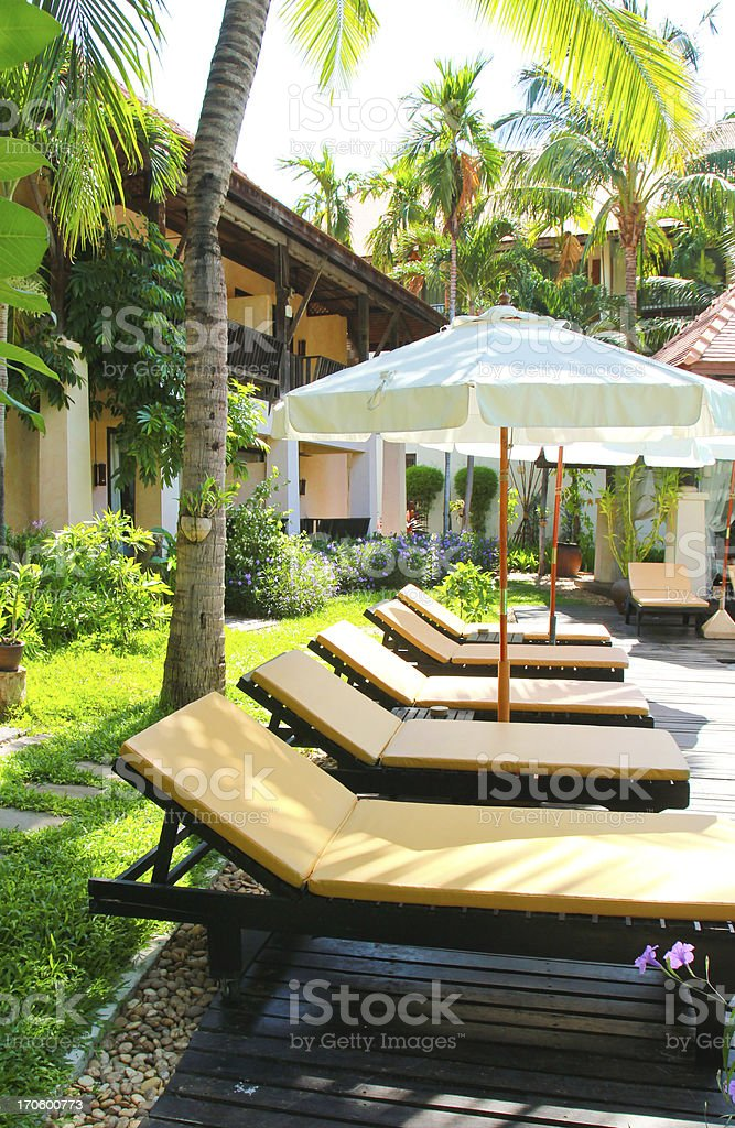 Beach chairs and umbrella side swimming pool royalty-free stock photo