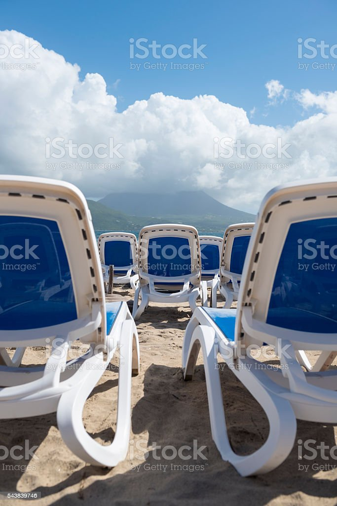 Beach chairs in the Caribbean on St. Kitts stock photo