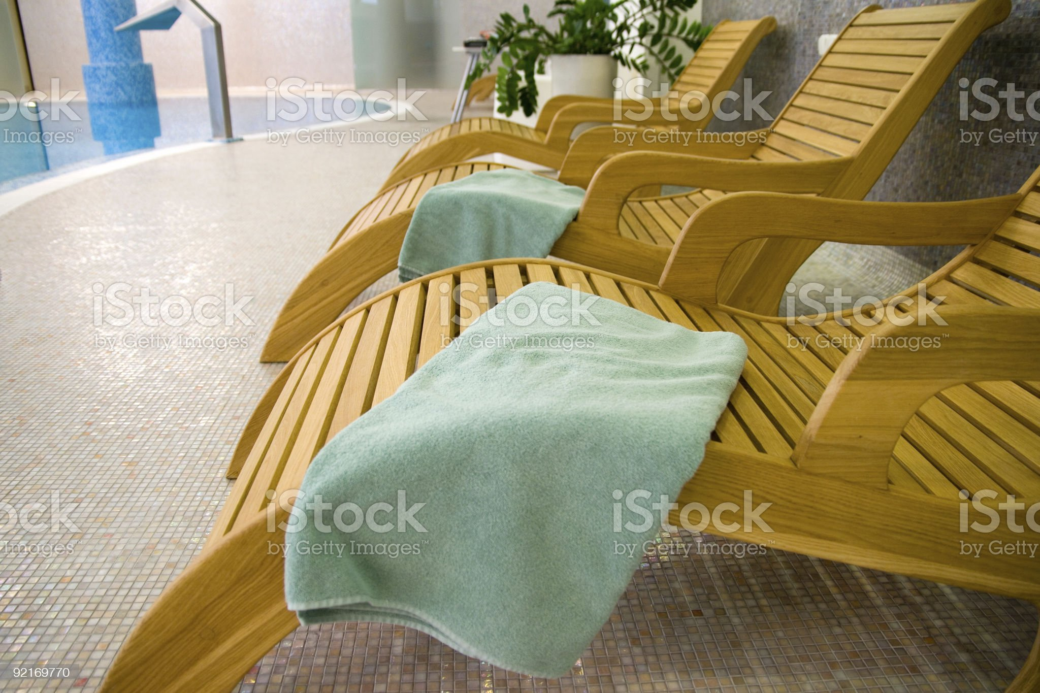 Beach chairs in the fitness with turquoise towel royalty-free stock photo