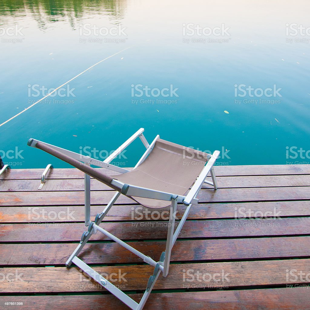 Beach chairs on perfect tropical lake stock photo
