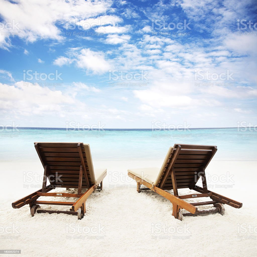 Beach chairs on the sand stock photo