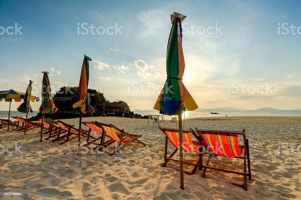Beach chairs on the white sand beach. stock photo