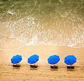 Beach chairs, umbrellas and ocean waves