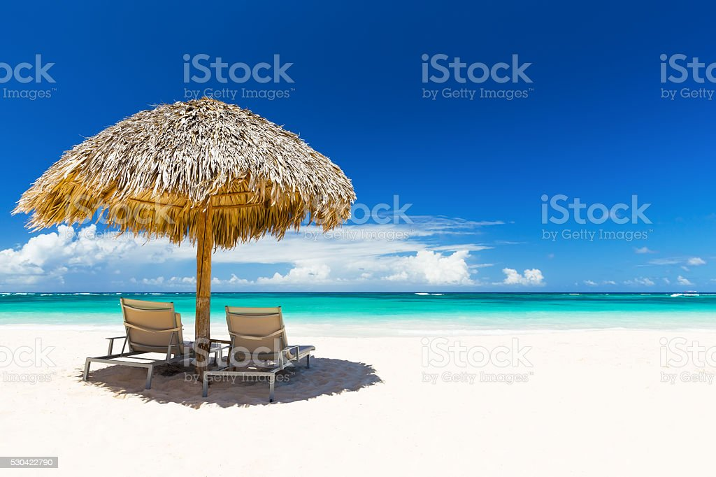 Beach chairs with umbrella and beautiful sand beach stock photo