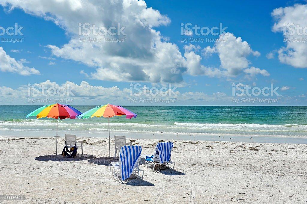 Beach Chairs with Umbrellas stock photo