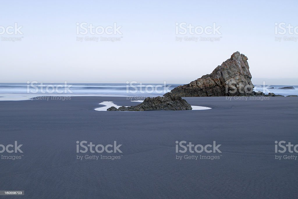 beach cloudy blue whith stone in north of spain stock photo