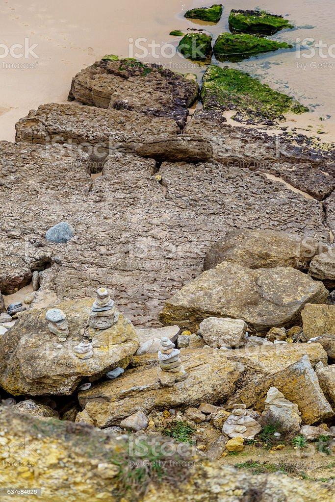 beach coastline with stones and sand stock photo