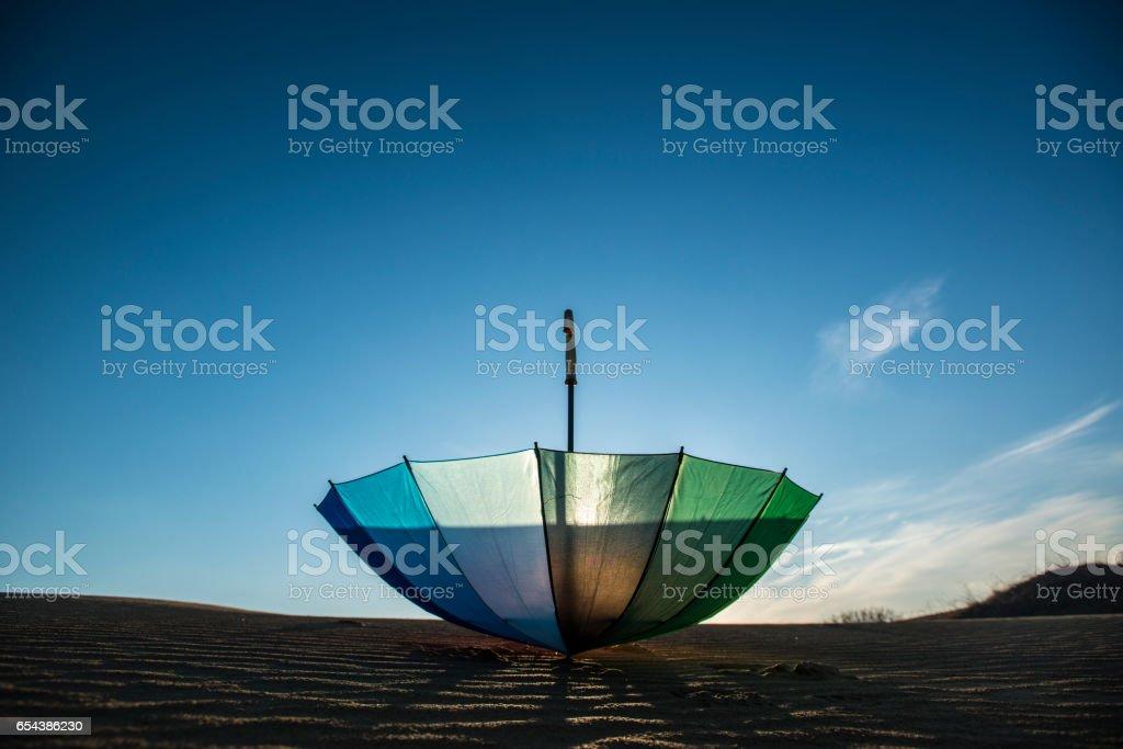 Beach colorfull umbrella on a sunny day. stock photo