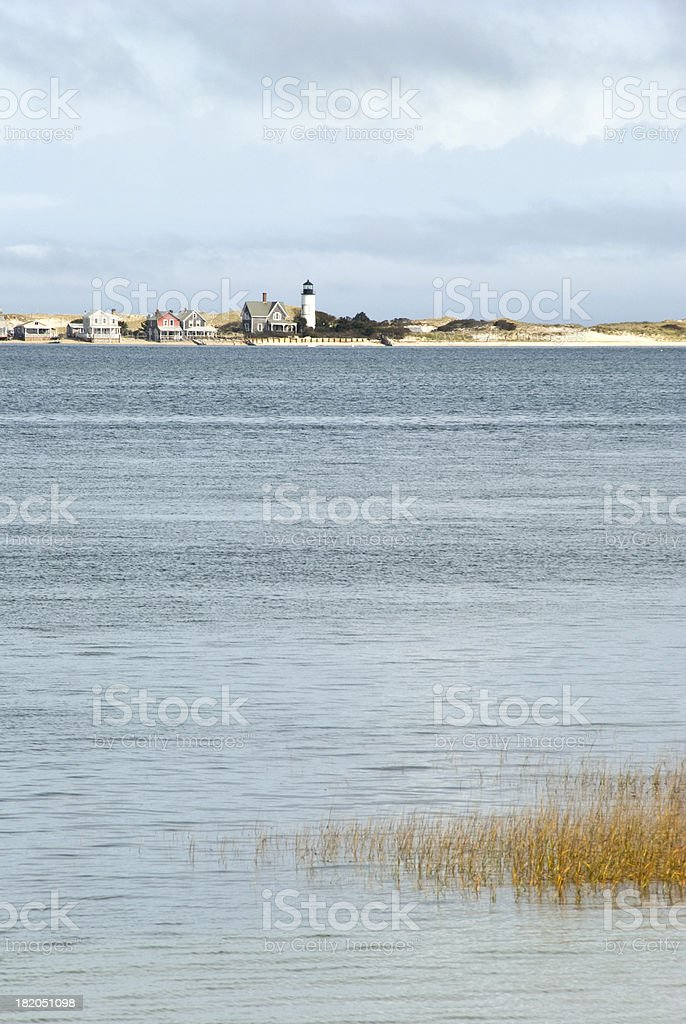 Beach Cottages and Lighthouse royalty-free stock photo