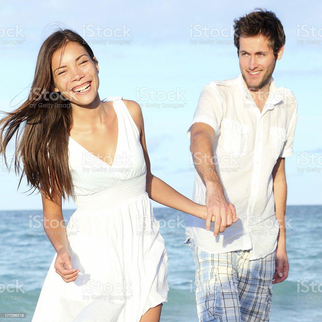 Beach couple walking happy royalty-free stock photo