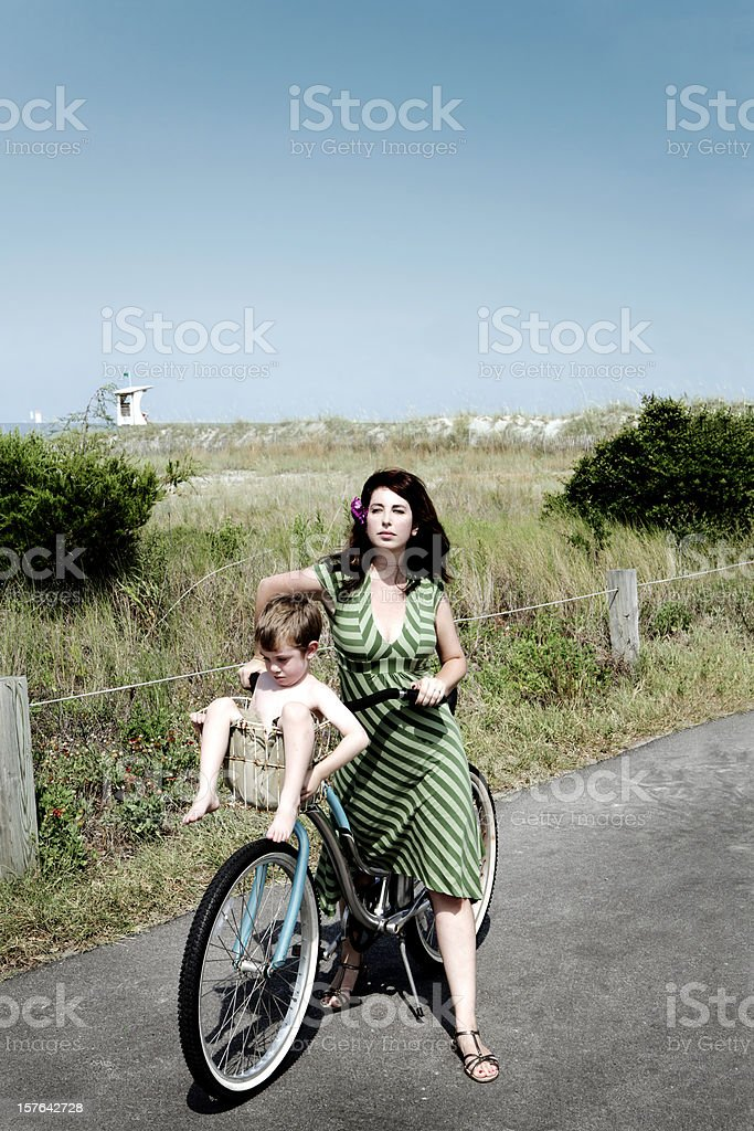 Beach Cruiser Woman and Child on Vacation stock photo