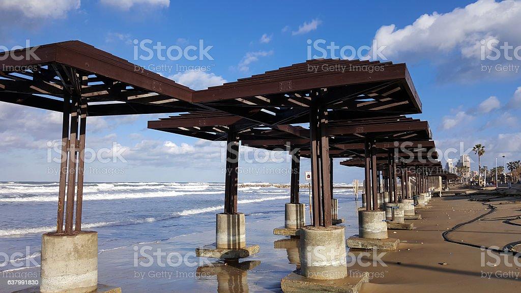 Beach damaged by water after storm, daylight, Mediterranean Sea, Haifa stock photo