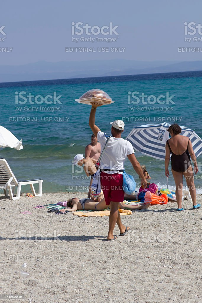 Beach donut seller royalty-free stock photo