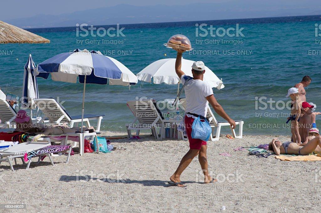 Beach donut seller stock photo