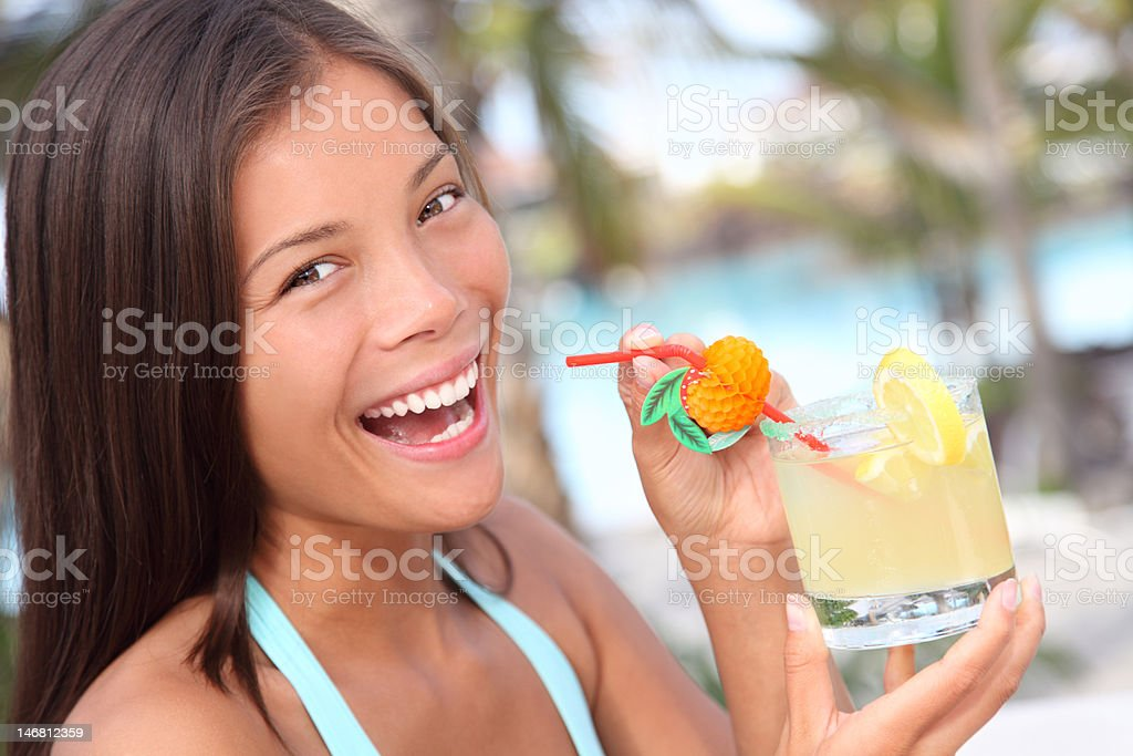 Beach drink woman at resort royalty-free stock photo