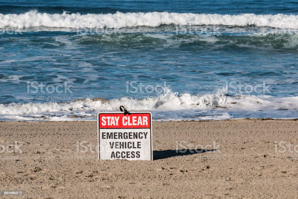 Emergency vehicle access sign at Mission Beach in San Diego,...