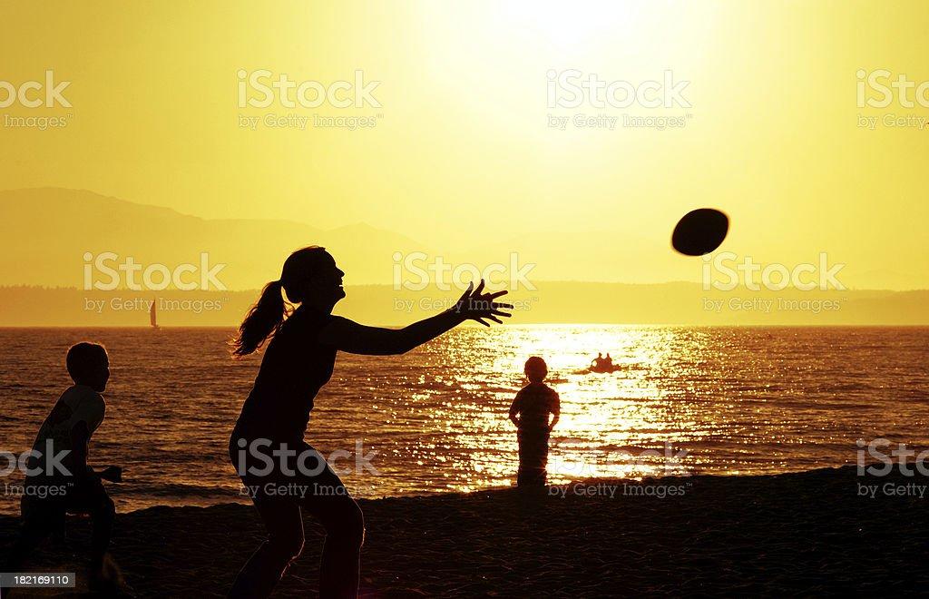 Beach Football - Family at Sunset royalty-free stock photo