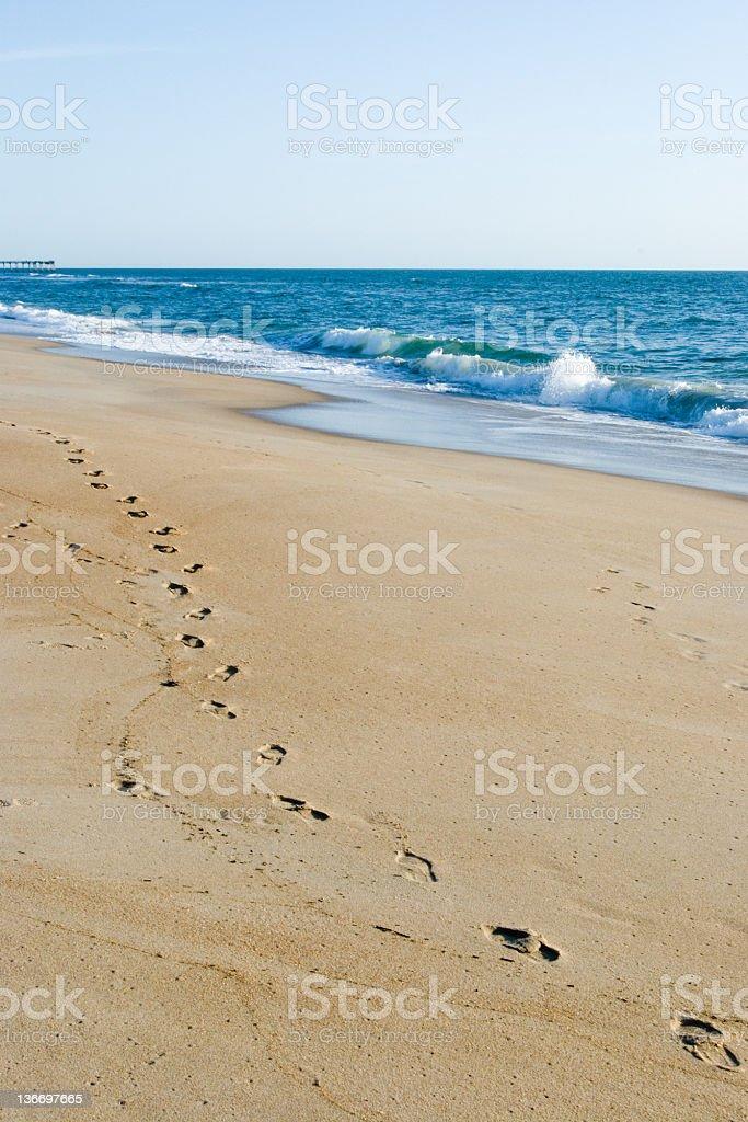 Beach Footprints and Ocean Waves stock photo
